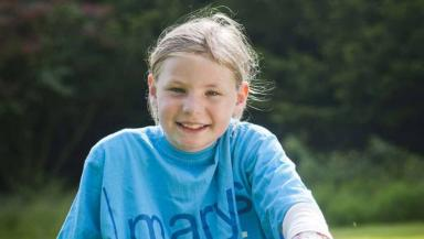 Martha Payne in Mary's Meals t-shirt.