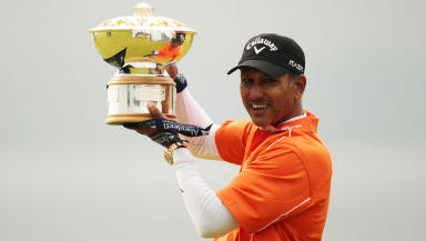 India's Singh poses with winners trophy after winning Scottish Open golf tournament near Inverness, Scotland