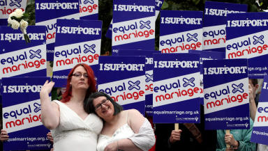 Quality shot of same-sex marriage campaigners outside the Scottish Parliament.