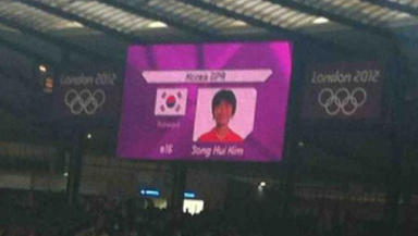 Blunder: North Korean players were announced as the South Korean flag was displayed.