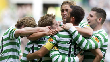 Kris Commons with team-mates.