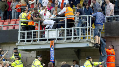 Quality image of fans clashing at Dundee United Dynamo Moscow Europa League tie at Tannadice.