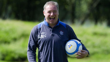 Rangers manager Ally McCoist watches over training in August 2012.
