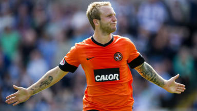 Dundee United striker Johnny Russell celebrates his second goal in the Dundee derby in August 2012.