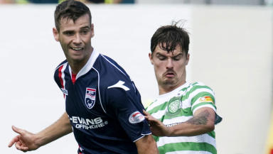 Celtic defender Mikael Lustig (right) closes down Stuart Kettlewell.