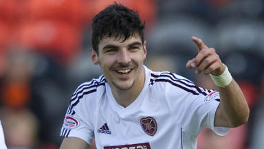 Callum Paterson celebrates after opening the scoring for Hearts