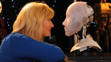 Looking to the future: Exhibition development officer Linda Barrett with NS5 robot head