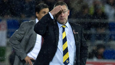 The strain shows on the face of Scotland manager Craig Levein as his side slump to their first defeat of the campaign.