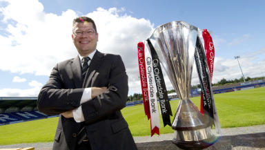 SPL chief executive Neil Doncaster poses with the SPL trophy at the start of the 2012/13 season.