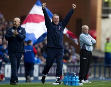 Ally McCoist celebrates his side's win over Queen's Park.