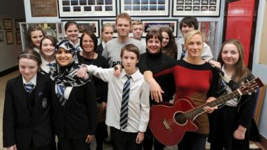 Students from Lourdes Secondary with rapper MC Loki