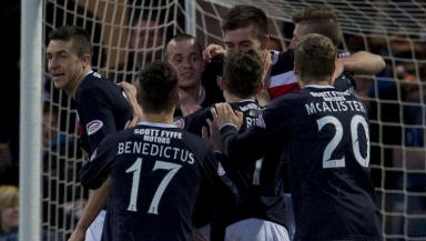 Steven Milne (3rd left) celebrates his goal for Dundee with team mates.