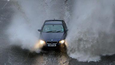 Car in flooded motorway road, illustrating flooding, weather, bad weather, transport, cars or flood. Quality image, November 2012