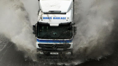 Lorry in flooded motorway road, illustrating flooding, weather, rain, bad weather, transport, cars or flood. Quality image