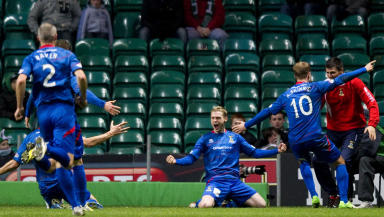 Billy McKay (centre) celebrates with his team mates after scoring to give ICT the lead
