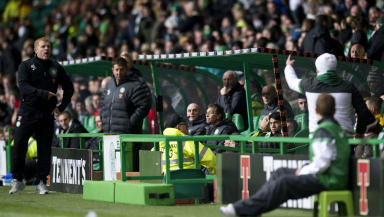 Celtic manager Neil Lennon (left) has a word with a Celtic fan