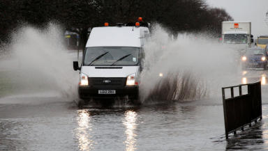 Van commuter traffic driving through flooding during flood rain weather in Glasgow November 2012 quality image