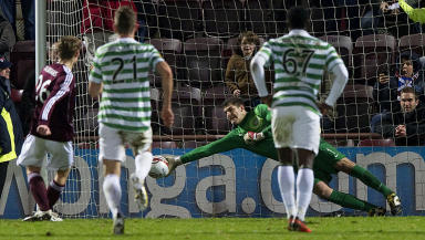 Hearts captain Marius Zaliukas (left) sees his penalty saved by the on-form Fraser Forster