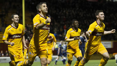 Motherwell's Keith Lasley (centre) races off to celebrate his late winner.