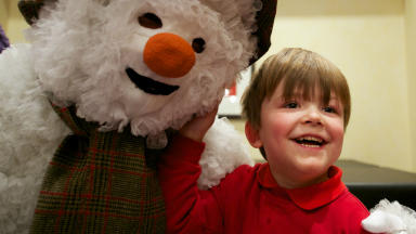 The Snowman: Sean Paterson (aged 6) from Braidburn School makes a new snowy friend.