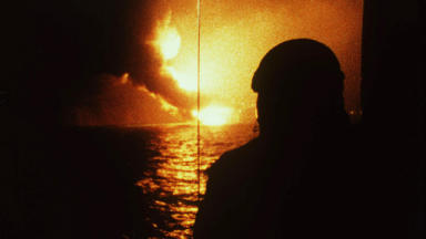 Piper Alpha disaster: a worker watches as the rig goes up in flames
