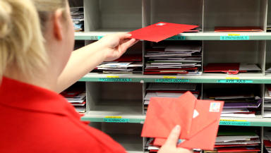Royal Mail sorting office in Springburn, Glasgow, during busiest week of the year before Christmas.