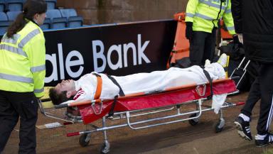 Aberdeen defender Andrew Considine is stretchered off