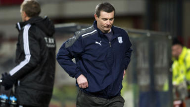 Dundee manager Barry Smith seems displeased as he heads for the dressing room.