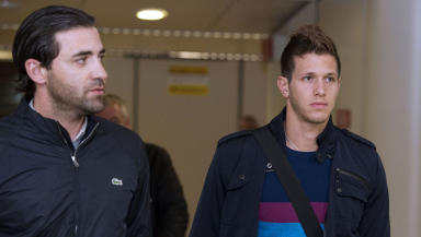 Celtic transfer target Rami Gershon arrives in Glasgow with his agent Dudu Dahan (left).
