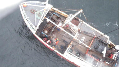 View from a navy helicopter of the Amy Harris which caught fire off Arran in January 2013.