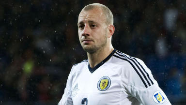 Alan Hutton in action for Scotland.