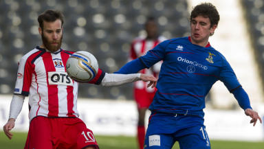 Kilmarnock's James Dayton (left) and Aaron Doran fight for possesion.