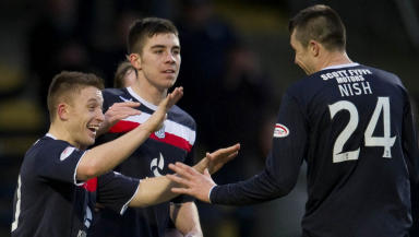 John Baird (left) celebrates with Dundee scorer Colin Nish as the home side go 4-1 ahead