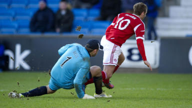 Niall McGinn is brought down by Cammy Bell.