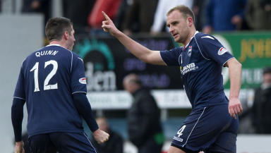 Grant Munro (right) celebrates his goal with Ross County team mate Rocco Quinn.