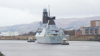 HMS Duncan leaves its home at Scotstoun on the River Clyde as it moves to Portsmouth for Royal Navy handover