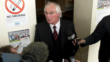 Dunfermline's Director of Football Jim Leishman (centre) announces to the press that the club will apply for administration.
