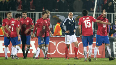 Scotland's Alan Hutton (centre) and Grant Hanley (right) look on as Filip Duricic (19) celebrates his second goal of the night with his team-mates