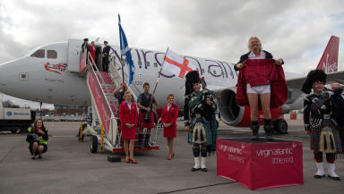 Richard Branson lifts his kilt after arriving on the Inaugural Virgin Little Red flight from London to Edinburgh.
