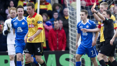 Partick Thistle's Aaron Muirhead (left) is shown a red card after clashing with Chris Higgins.