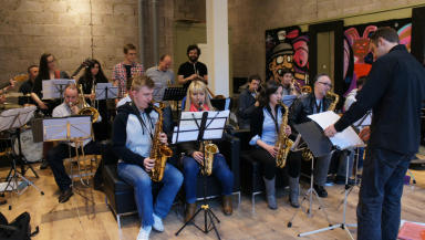 Music festival: The Zig Zag Big Band rehearse at Men International, a city centre barbers.
