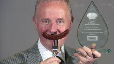 Inverness butcher Duncan Fraser poses with prize-winning sausage.