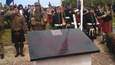 War memorial unveiled in Mauny, where six Black Watch soldiers died liberating the village.