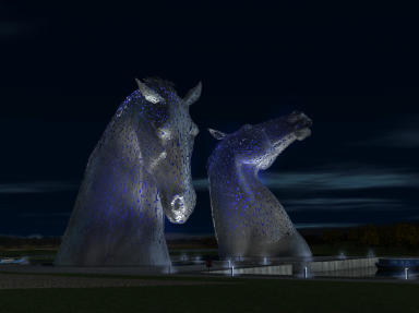 The Kelpies glow by night.