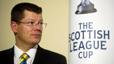 SPFL Chief Executive Neil Doncaster helps to make the draw for the Scottish League Cup First Round