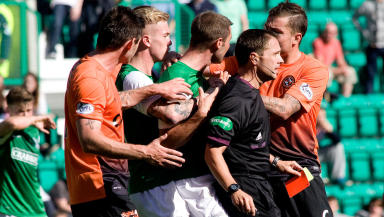 Referee Crawford Allan tries to maintain control as Kevin Thomson (centre) continues to argue despite being sent off for his clash with Gavin Gunning