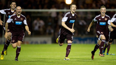 Hearts captain Danny Wilson (centre) and his team mates rush to celebrate with penalty shoot-out hero Brad McKay after sending Hearts through to the 3rd round of the Scottish League Cup