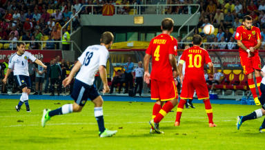 Scotland's Shaun Maloney (left) scores the winning goal of the game with a stunning free-kick
