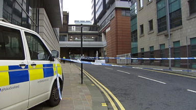 Body of a man in his 30s found outside Blythswood Court flats in Cadzow Street, Glasgow.