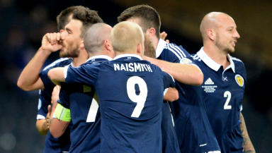 Scotland's Robert Snodgrass (left) celebrates after opening the scoring with a header